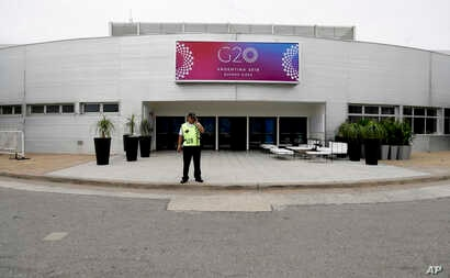 A security guard stands outside the G20 summit venue at the Costa Salguero Center, Buenos Aires, Argentina, Nov. 27, 2018.