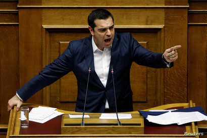 Greek Prime Minister Alexis Tsipras addresses lawmakers during a parliamentary session before a vote on an accord between Greece and Macedonia changing the former Yugoslav republic's name in Athens, Greece, Jan. 24, 2019.