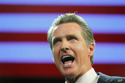 FILE - California Democratic gubernatorial candidate Gavin Newsom speaks after  being elected governor of the state during an election night party in Los Angeles, Nov. 6, 2018.