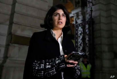 Daniela Tejada reads a statement for the media as she leaves The Foreign Office after a meeting with Britain's Foreign Secretary Jeremy Hunt, in London, Thursday, Nov. 22, 2018.