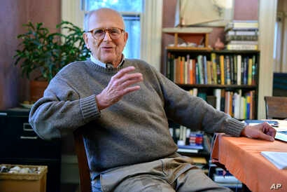 Rainer Weiss, one of three awarded this year's Nobel Prize in physics, poses for a photograph at his home in Newton, Mass., Oct. 3, 2017.