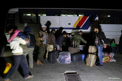 People who have evacuated from Madaya, a government-besieged town near Damascus, in an agreement between rebels and Syria's army, arrive at insurgent-held Idlib city, Syria, April 15, 2017.
