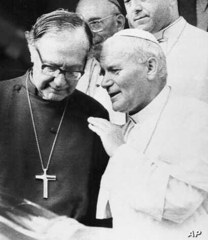 Pope John Paul II meets with the Archbishop of Canterbury Robert Runcie, left, head of the Anglican Church, in Accra, Ghana, May 9, 1980.
