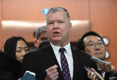 """U.S. special representative on North Korea Stephen Biegun, center, speaks to reporters as his South Korean counterpart Lee Do-hoon, right,   looks on after their """"working group"""" meeting handling North Korean issues at the Foreign Ministry in Seoul on..."""