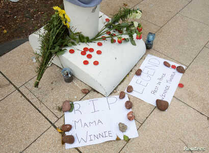 People pay their respects to Winnie Madikizela-Mandela with messages of condolence and flowers in Durban, South Africa, April 3, 2018.