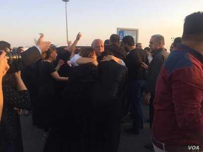 Families weep when the bodies of their loved ones are returned after dying at sea in an attempt to get to Europe. Both protesters and mourners say they are seeking better lives in Irbil, Kurdistan Region of Iraq, Sept. 29, 2017.