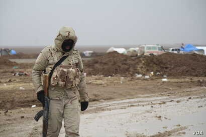 In the western deserts, soldiers contend with increasingly cold temperatures and winter mud, sometimes a foot deep in Nineveh province, Iraq, Dec. 15, 2016.