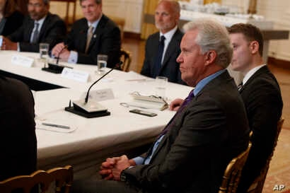 "GE CEO Jeff Immelt listens during the ""American Leadership in Emerging Technology"" event with President Donald Trump in the East Room of the White House, June 22, 2017, in Washington."