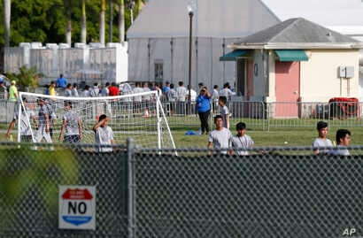 FILE- Immigrant children play outside a former Job Corps site that now houses them in Homestead, Fla., June 18, 2018.