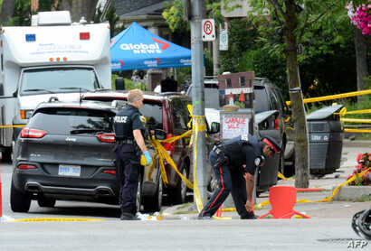 Toronto Police investigate the scene of a shooting from the night before in Toronto, Ontario, Canada on July 23, 2018.
