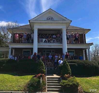 Members of Delta Kappa Epsilon pose with friends outside their fraternity house near the campus of Virginia Tech in Blacksburg, Va.