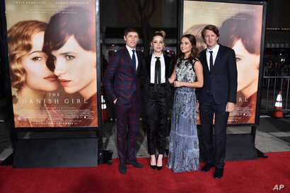 "From left, Eddie Redmayne, Amber Heard, Alicia Vikander and Tom Hooper arrive at the premiere of ""The Danish Girl"" at Regency Village Theatre, Nov. 21, 2015, in Los Angeles, California."