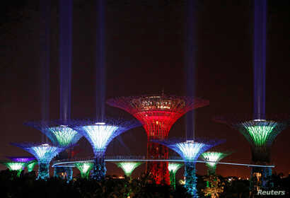 """Supertree structures transform into """"lightsabers"""" during activities to mark """"May the 4th"""" Star Wars Day at Gardens by the Bay in Singapore May 4, 2017."""