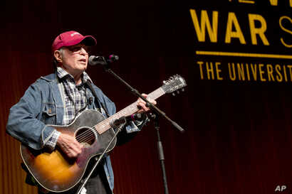 FILE - Singer-songwriter Country Joe McDonald performs at the Vietnam War Summit at the LBJ Presidential Library in Austin, Texas, April 28, 2016.