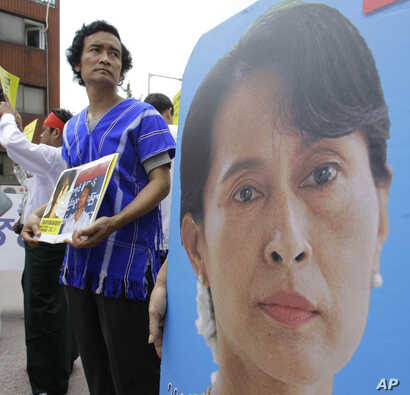 FILE - A Myanmar's activist holds a picture of their leader Aung San Suu Kyi during a rally calling for the immediate release of their pro-democracy leader Aung San Suu Kyi and her colleagues near the Myanmar Embassy in Seoul, Aug. 8, 2010.