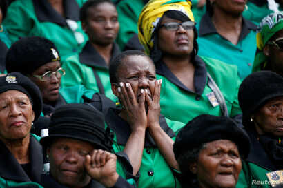Mourners attend a memorial service for Winnie Madikizela-Mandela at Orlando Stadium in Johannesburg's Soweto township, South Africa, April 11, 2018.
