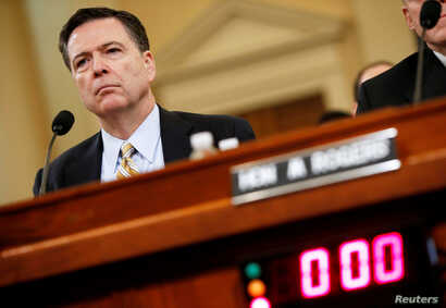 FILE: FBI Director James Comey testifies before the House Intelligence Committee hearing into alleged Russian meddling in the 2016 U.S. election, on Capitol Hill in Washington.