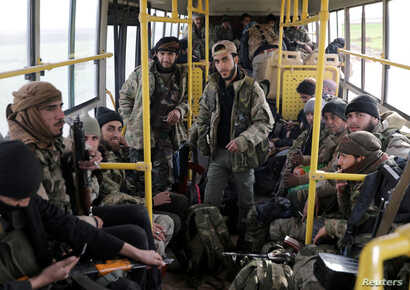 Turkish-backed Free Syrian Army fighters are on a bus in the town of al-Rai, Syria, Feb. 14, 2018.