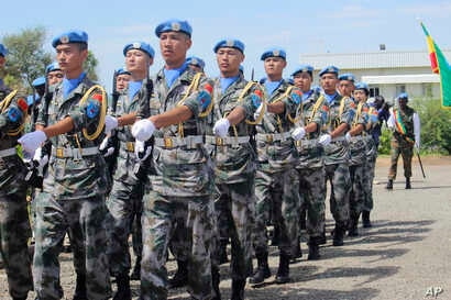 United Nations Chinese soldiers of the United Nations Mission to South Sudan march as they celebrate the International Day of United Nations Peacekeepers, May 29, 2017 in Juba.