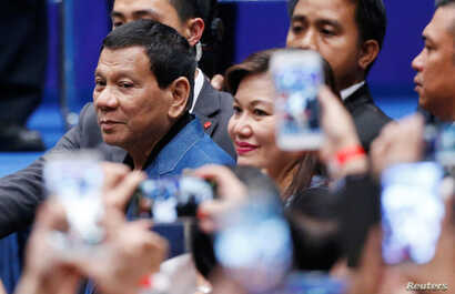 Philippine President Rodrigo Duterte arrives at an event with Filipino community in Hong Kong, April 12, 2018.