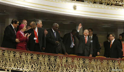 Cuba's President Raul Castro waves to the audience as he takes his seat near Cuba's prima ballerina, Alicia Alonso, second left, before U.S. President Barack Obama speaks at the Gran Teatro, in Havana, Cuba, March 22, 2016.