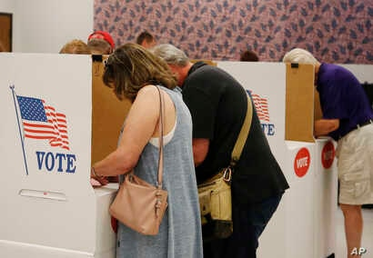 People vote early at the Oklahoma County Board of Elections, June 21, 2018, in Oklahoma City.