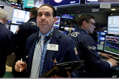 Trader Tommy Kalikas works on the floor of the New York Stock Exchange, Feb. 5, 2018.