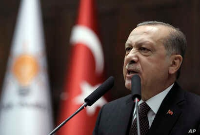 Turkey's President and leader of ruling Justice and Development Party Recep Tayyip Erdogan addresses supporters and lawmakers at the parliament in Ankara, Turkey, Jan. 9, 2018.