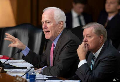 Sen. John Cornyn, R-Texas, left, chairman of the Subcommittee on Immigration, Refugees and Border Security, joined at right by Sen. Lindsey Graham, R-S.C., chairman of the Subcommittee on Crime and Terrorism, questions witnesses as the Senate Judicia...