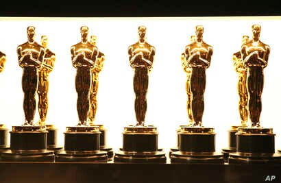 FILE -  Oscar statuettes appear backstage at the Oscars in Los Angeles.