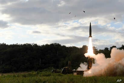 In this photo provided by South Korea Defense Ministry, South Korea's Hyunmoo II ballistic missile is fired during an exercise at an undisclosed location in South Korea, Sept. 15, 2017.