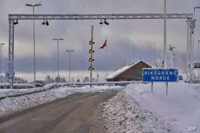 A sign at the entrance of the border post informs travelers that they are entering Norway, Feb. 8 2019. Norway's membership in the European Economic Area grants it access to the common market and most goods are exempt from paying duties but everythin...