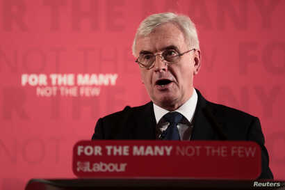 FILE - Britain's Shadow Finance Minister John McDonnell, speaks as he sets out Labour's demands for the Spring Statement, in London, Britain, March 9, 2018.