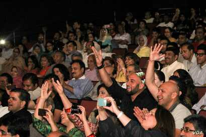 An audience cheers at a Qawwali concert by Amjad Sabri in Annandale, Virginia, in 2013. Qawwali music received international exposure through the work of the late Pakistani artists Nusrat Fateh Ali Khan, Aziz Mian Qawwal and the Sabri Brothers. After...