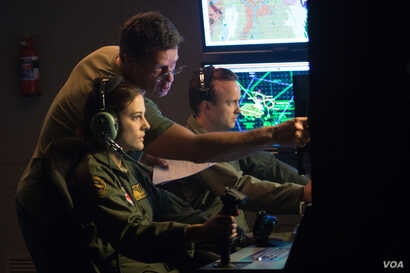 (Left to Right) Actress Phoebe Fox, director Gavin Hood and actor Aaron Paul on the set of EYE IN THE SKY, a Bleecker Street release.