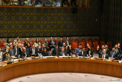 Ambassadors to the U.N. vote during a United Nations Security Council meeting on North Korea in New York City, Sept. 11, 2017.