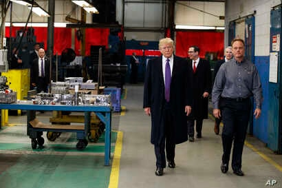 President Donald Trump participates in a tour of Sheffer Corporation during a visit to promote his tax policy, Feb. 5, 2018, in Blue Ash, Ohio.