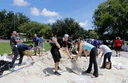 City of Miami volunteers help residents fill free sandbags as residents prepare for Hurricane Irma, Sept. 7, 2017.