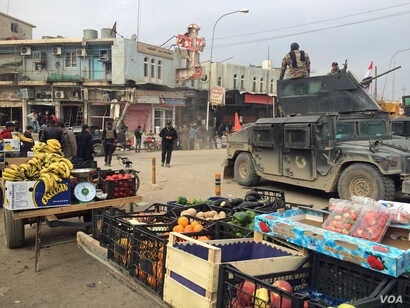 The scene directly outside the My Beautiful Lady restaurant three weeks before the bombing when the neighborhood was suddenly coming back to life in Mosul, Iraq, Jan. 21, 2017.