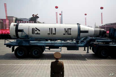In this April 15, 2017 photo, a submarine missile is paraded across Kim Il Sung Square during a military parade, in Pyongyang, North Korea to celebrate the 105th birth anniversary of Kim Il Sung, the country's late founder.