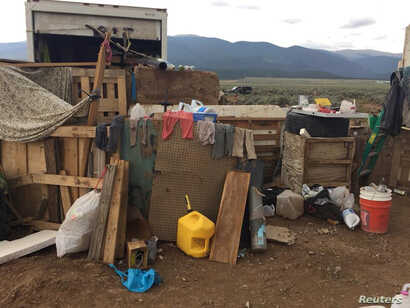 Conditions at a compound in rural New Mexico where 11 children were taken into protective custody for their own health and safety after a raid by authorities, are shown in this photo near Amalia, New Mexico, provided Aug. 6, 2018.