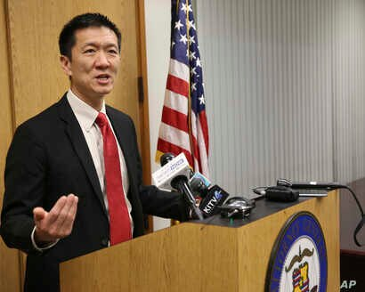 Hawaii Attorney General Douglas Chin speaks at a news conference, March 9, 2107, in Honolulu. Chin's office filed an amended lawsuit against President Donald Trump's revised travel ban.