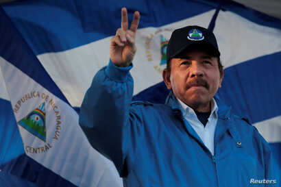 "FILE - Nicaraguan President Daniel Ortega gestures during a march called ""We walk for peace and life. Justice"" in Managua, Nicaragua, Sept. 5,2018."