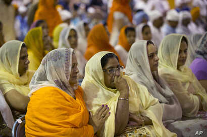 Mourners attend the funeral and memorial service for the six victims of the Sikh temple of Wisconsin mass shooting in Oak Creek, Wisconsin, Friday, Aug 10, 2012.