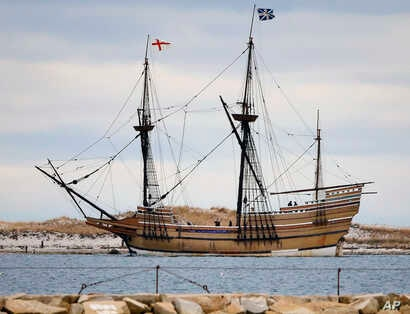 FILE - In this Dec. 12, 2014 file photo, the Mayflower II, a replica of the original ship that brought Pilgrims to Massachusetts in 1620, passes a jetty as it is towed out of Plymouth Harbor in Plymouth, Mass.