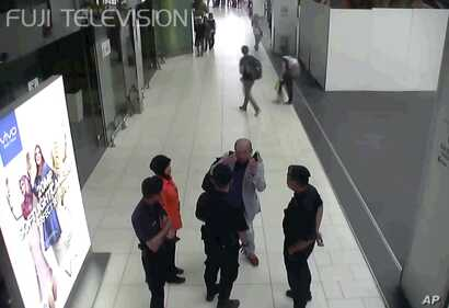 FILE - Kim Jong Nam, exiled half brother of North Korea's leader Kim Jong Un, gestures toward his face while talking to airport security and officials at Kuala Lumpur International Airport, Malaysia, in this image made Feb. 13, 2017, from Kuala Lumpu...