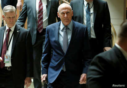 Director of National Intelligence Dan Coats arrives for a closed senators-only Capitol Hill briefing on election security at the U.S. Capitol in Washington, Aug. 22, 2018.