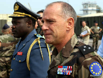 FILE - French General Christian Damay (R), commander of the EU Force in Congo, and General John Numbi (L), head of Congo's Airforce, inspect the EU Force base in Kinshasa.