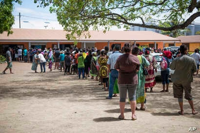 Residents of New Caledonia's capital, Noumea, wait in line at a polling station before casting their vote as part of an independence referendum, Nov. 4, 2018. Voters in New Caledonia are deciding whether the French territory in the South Pacific shou...