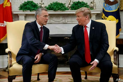President Donald Trump shakes hands with with NATO Secretary General Jens Stoltenberg during a meeting in the Oval Office of the White House,  April 2, 2019 in Washington.